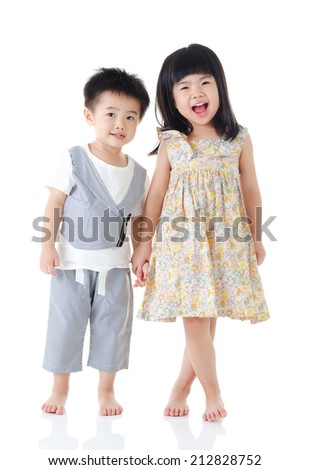 Asian kids standing and holding hands - stock photo