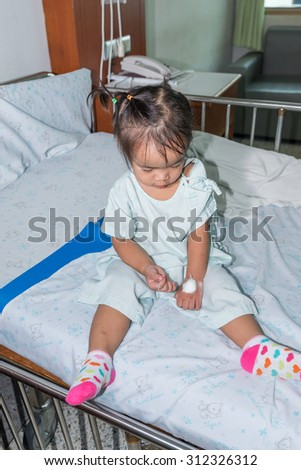 Asian Kids (Thai) Girl On A Bed In Hospital