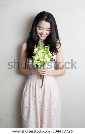 http://thumb9.shutterstock.com/display_pic_with_logo/1839311/304499726/stock-photo-asian-lady-holding-a-bunch-of-flower-standing-against-a-wall-304499726.jpg