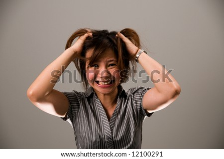 Asian lady in business attire, feeling frustrated