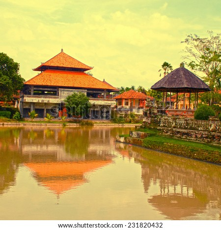 Asian landscape with traditional house and river(Bali, Indonesia). Square toned image, instagram effect
