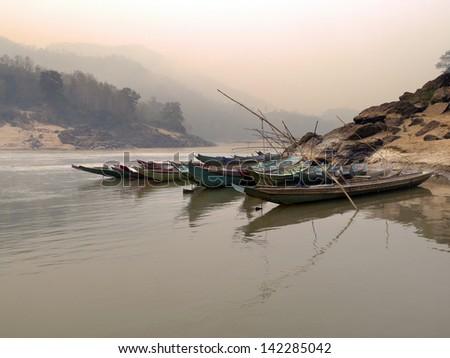 asian life port of little village riverside Mekong River, Laos - stock photo