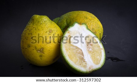 Asian lime fruit known as Limau Jebo or Limau Jebur. Slightly de-focused and close-up shot. Copy space.