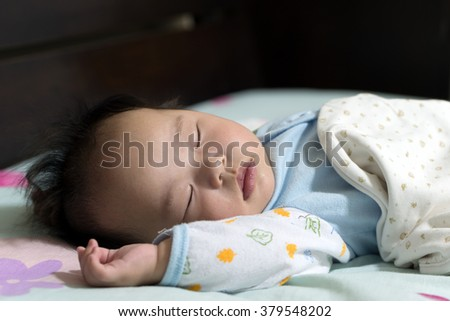 Asian little baby boy is sleeping peacefully