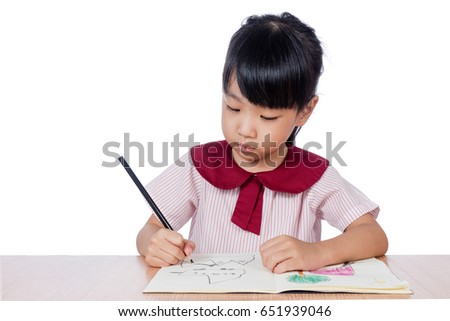 Asian Little Chinese girl drawing with color pencils in isolated white background