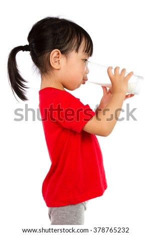 Asian Little Chinese Girl Drinking a cup of Milk isolated on White Background - stock photo