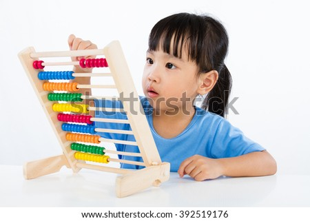 Asian Little Chinese Girl Playing Colorful Abacus isolated on White Background - stock photo