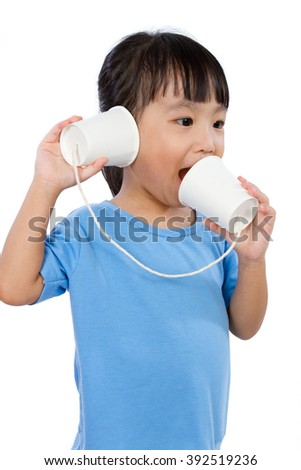 Asian Little Chinese Girl Playing with Paper Cups isolated on White Background - stock photo
