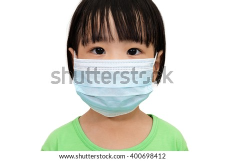 Asian Little Chinese Girl Wearing a Protective Mask in Isolated White Background. - stock photo