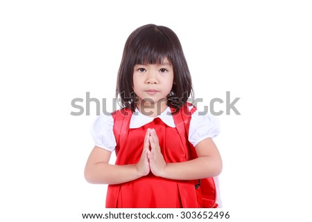 Asian little girl acting sawaddee mean Hello on isolated background