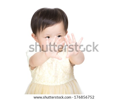 Asian little girl looking her hand