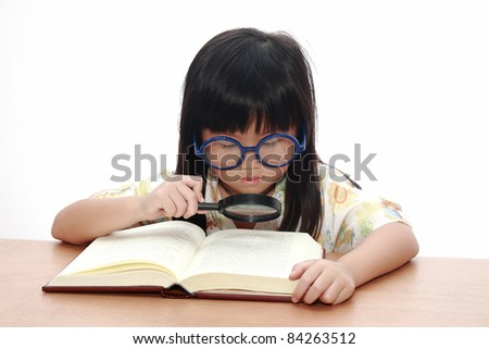 Asian little girl reading a book with magnifying glass isolated on a over white background