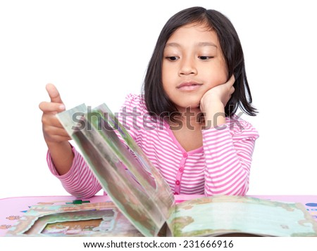 Asian Little Girl reading story book isolated - stock photo