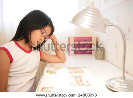 asian little girl studying over table at home - stock photo
