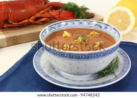 Asian lobster soup with fresh lemon, dill and bread - stock photo