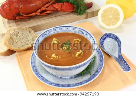 Asian lobster soup with lemon, dill and bread - stock photo