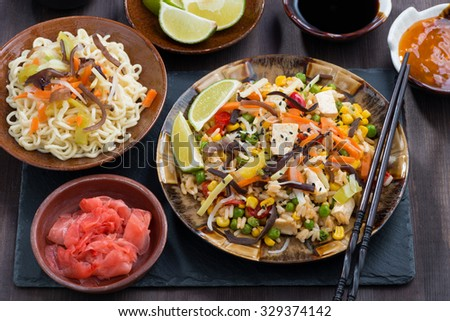 asian lunch - fried rice with tofu and vegetables, top view, horizontal