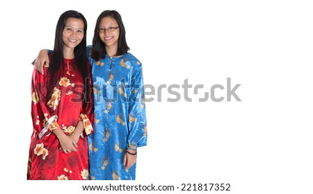 Asian Malay mother and daughter in traditional dress over white background