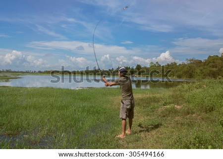 Asian male fish in the reservoir. - stock photo