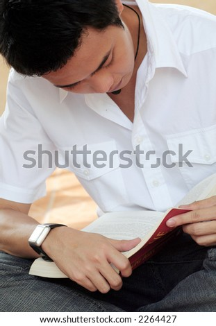 Asian Male reading Book