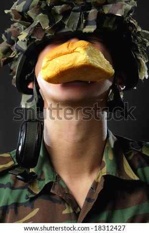 "asian man dressed as a ""food"" soldier - stock photo"