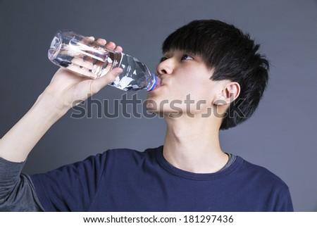 Asian man drinking water - stock photo