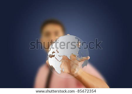 Asian man holding a glowing earth globe in his hand. - stock photo
