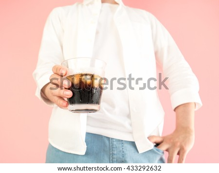 Asian man holding a iced coffee