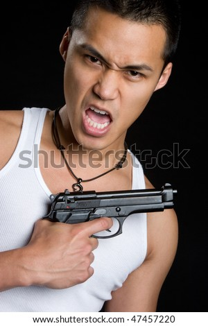 Asian Man Holding Gun - stock photo