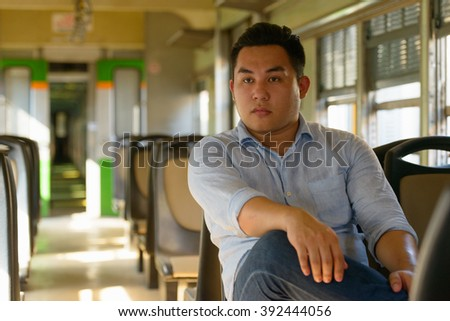 Asian man in train