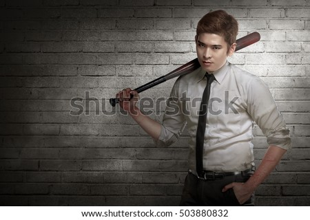 Asian man in white shirt and tie holding baseball bat
