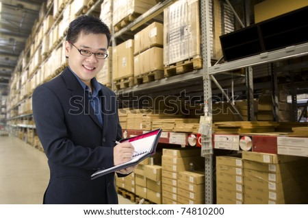 asian man inside a factory - stock photo