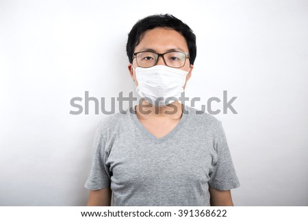 Asian man is sick with mask  - stock photo