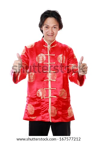 Asian man is smile and hand with thumb up in chinese new year day,on white background - stock photo