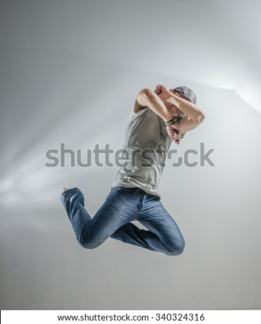 Asian Man Jumping Pose Action - stock photo