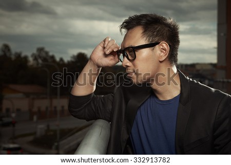 Asian man posing outdoor for portraits - stock photo