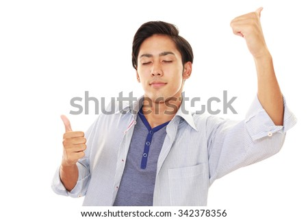 Asian man showing thumbs up sign  - stock photo