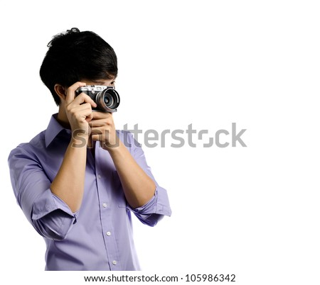 Asian man take photo with a retro camera