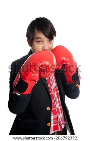 Asian man wear boxing gloves keep his guard up  isolated on white background