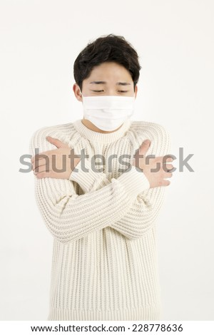 Asian man wearing a face mask - stock photo