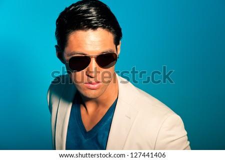 Asian man wearing suit and sunglasses. Summer fashion. Studio. - stock photo