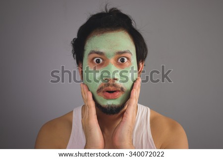 Asian man with face mask skincare. - stock photo