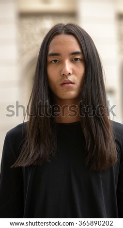 Asian man with long hairstyle outdoors
