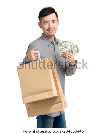 Asian man with paper bag and cash - stock photo