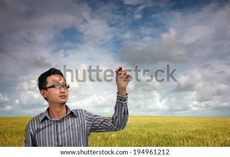 asian man with pen tool and blank copyspace, suitable for technology related wordings - stock photo