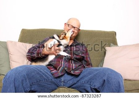 Asian man with pet dog.