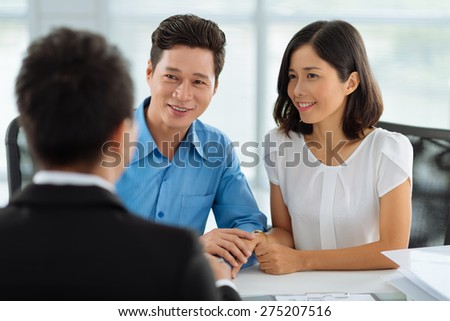 Asian married couple at the meeting with real estate agent - stock photo