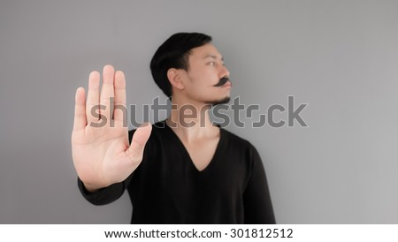 Asian mean office manager with his elegant mustache - stock photo