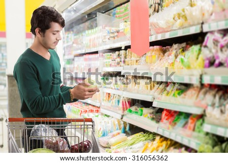 Asian men are choosing to shop In the supermarket - stock photo