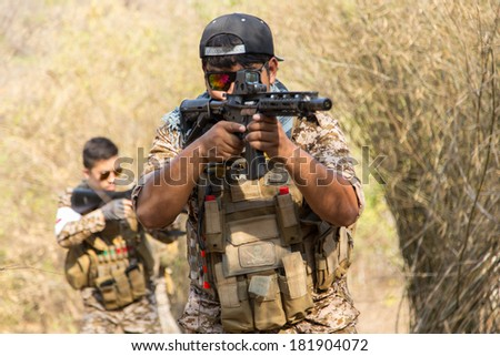Asian men soldier training gun tactic - stock photo